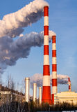 Gas power plant in sunny day. Pipes with smoke. Energy industry concept Stock Images