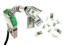 Gas Prices. Green fuel nozzle with dollars flying around Royalty Free Stock Photos
