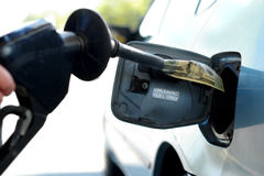 Gas prices. Putting money into the tank (high gas prices Stock Images