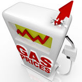 Gas Prices - Arrow Rising at Gasoline Pump. A red arrow crashes through top of gasoline pump over the words Gas Prices Royalty Free Stock Photography