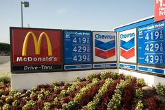 Gas prices Chevron McDonald's. LOS ANGELES, CALIFORNIA, USA - APRIL 19th 2011: Chevron's reader's board indicating their gas prices and a McDonald's logo Royalty Free Stock Photography