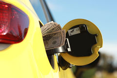 Gas Prices. Concept on the yellow car Royalty Free Stock Photos