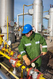 Gas Production Operator. Gas oil production operator works and maintains well site or compressor station Royalty Free Stock Image