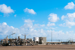 Gas production well and blue sky Royalty Free Stock Image