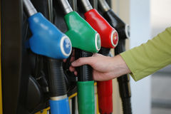 Gas pump. Closeup hand gas pump nozzle gas station Stock Photography