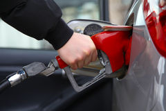 Gas Pump. Refilling automobile fuel. Shallow focus Royalty Free Stock Images