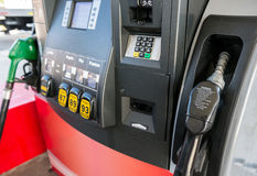 Gas pump. Close up with nozzle in foreground Royalty Free Stock Photos
