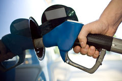 Gas pump. Close-up of a mens hand refilling the car with a gas pump Stock Photos