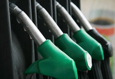 Gas pump. Gas nozzles at the gas station. Shallow depth of field with focus on the first nozzle Stock Images