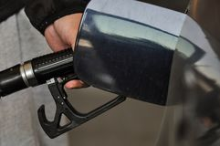 Gas pump. Close-up of a men hand refilling the car with a gas pump royalty free stock images