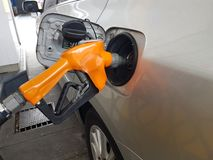 A Gas pump filling up a car. Gas pump filling up a car royalty free stock image