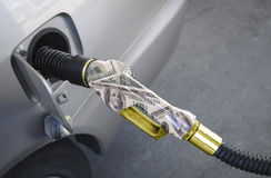 Gas Pump Gold nozzle Royalty Free Stock Photo
