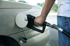 Gas pump in the hand. An image of gas pump in the hand stock photography