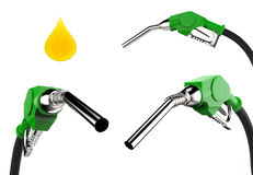 Gas pump nozzle with droplet of oil isolated on white Stock Images