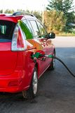 Gas pump nozzle in the fuel tank of a car. Royalty Free Stock Photography