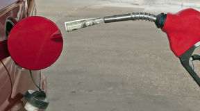Gas Pump Nozzle With A One Hundred Dollar Bill Stock Photography
