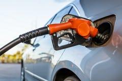 Gas pump nozzle stock photo