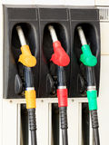 Gas pump nozzles. In a service station Stock Photo