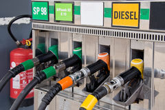 Gas pump nozzles Royalty Free Stock Image