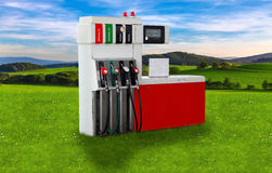 Gas pump nozzles over a nature background Stock Photos