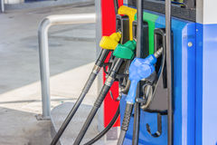 Gas pump nozzles in a service station Stock Photos