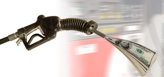 Gas pump pumping cash. Against motion blur background Royalty Free Stock Photo