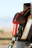 Gas pump rural. Gas pump close up in rural area - dirty grungy greasy with copyspace Royalty Free Stock Photo