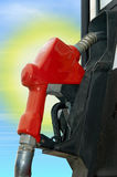 Gas pump with sun Royalty Free Stock Photos