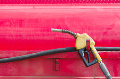Gas pumpeR. On red background Stock Photography