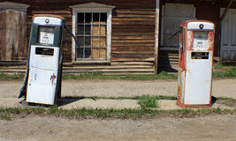 Gas Pumps. Old and broken down gas pumps in a ghost town in Montana Stock Image