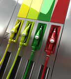 Gas pumps in colors. 3D rendering of four brightly colored gas pumps with empty labels Royalty Free Stock Images