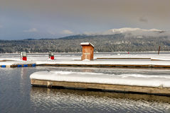 Gas pumps on a doc winter lake Stock Photo