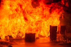 Gas Pumps Exploding. And dock engulfed in fire Royalty Free Stock Photos
