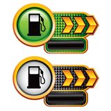 Gas pumps on gold arrow banners Stock Image