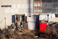 Gas pumps vintage. Gas pumps - vintage gas pumps at an abandoned gas station in rural America with hot coffee sign Stock Photography