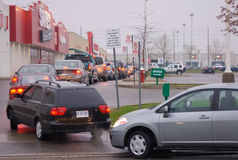 Gas  Queue in the Parking Lot. Hundredes of motorists line up for hours to buy half price gas in Mississauga, Canada on Friday, May 2nd, 2008 Royalty Free Stock Images