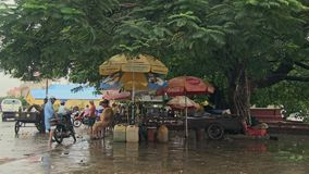 Gas, rain, street stall , cambodia, southeast asia stock video