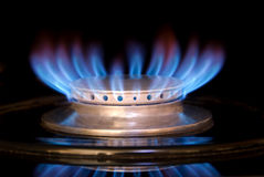 Gas Range Flame. A blue flame on a gas range isolated against a black marble splash Stock Photography