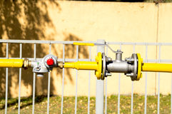 Gas reducer and the valve on the pipeline. Photo on the gas pressure regulator and the valve on the pipeline Stock Photography