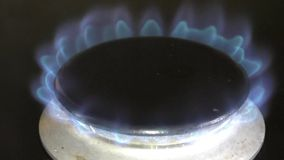 Gas ring igniting and burning stock video footage