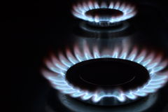Gas rings. 2 lit gas hob burners Royalty Free Stock Images