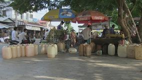 Gas , sale , street stall , cambodia, southeast asia stock video