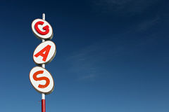 Gas sign retro. Style, red and white sign against blue sky with plenty of room for copy Royalty Free Stock Image