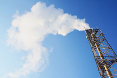 Gas. Smoke leaving a pipe. On blue sky Stock Photos