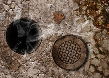 Gas smoke from open hole Royalty Free Stock Photos