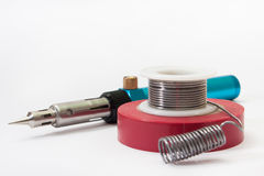 Gas soldering iron with tin and insulating tape Stock Photo
