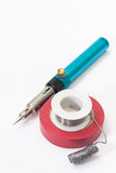 Gas soldering iron with tin and insulating tape Stock Photos