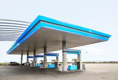 Gas station. Gas refuel station with blue roof close-up royalty free stock images