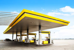 Gas station. Gas refuel station with yellow roof close-up stock image
