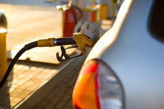 At the gas station. The scene at the gas station - petrol hose is inserted into the fuel tank car Stock Photography